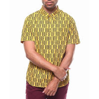 USA正規品 HUF ハフ 半袖 ボタンシャツ モノグラム 総柄 NIGHT MARKET イエロー 黄色 綿100% オールオーバーロゴ テキスタイル