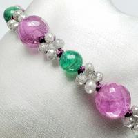 グレーダイヤモンドとピンクサファイア・エメラルドの組紐ブレスレット