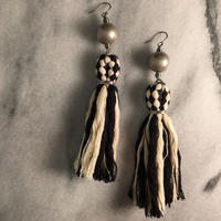 monotone tassel pierce