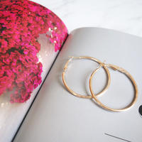 gold hoop pierce