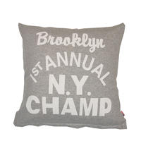 GRAPHIC CUSHION -N.Y. CHAMP-