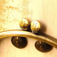 【HA-1239】スマイル刻印の碁石口金 10cm/くし型(アンティークゴールド)