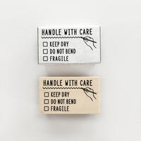 〈HANDLE WITH CARE〉スタンプ