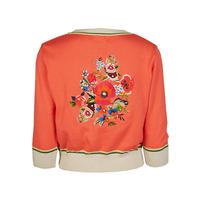 classic cardigan/floral corsage/coral
