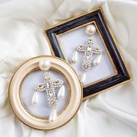 pearl cross earring