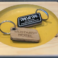 M&M-FURNITURE   MUSTARD HOTEL KEYRING  LIMITED BLACK EDITION M