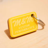 M&M-FURNITURE   MUSTARD HOTEL KEYRING  Yellow M