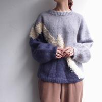 Blue × shaggy ecru knit