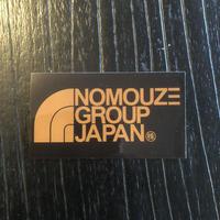 「NOMOUZE GROUP JAPAN」透明タイプステッカー/GOLD×BLACK