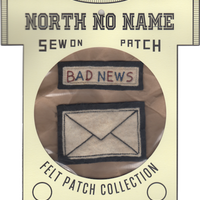 North No Name(ノースノーネーム)-FELT PATCH  BAD NEWS