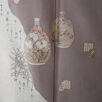 【袷】茶鼠系 道長取りに文様や和歌 色留袖