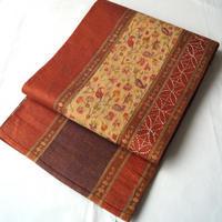 【ふくろ帯】パッチワーク風赤茶色更紗と刺し子の紬地洒落袋帯
