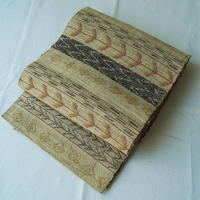 【夏帯】横段に様々な抽象文 手織り 麻 かがり名古屋帯
