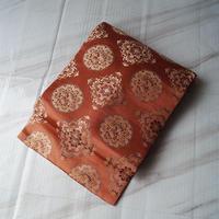 【なごや帯】濃曙色 緞子地 古典文様 セミアンティーク 織 なごや帯
