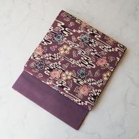 【なごや帯】京紫地 梅桜文 型染め 開き紬地なごや帯