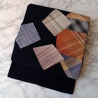 【ふくろ帯】黒地に組み織調織り柄の切り嵌め 洒落ふくろ帯