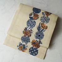 【夏なごや帯】生成り色 型染め丸文つなぎ 紬なごや帯