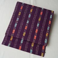 【なごや帯】紫の縮緬地カラフルモチーフの染めなごや帯