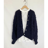 knit cardigan with pompoms