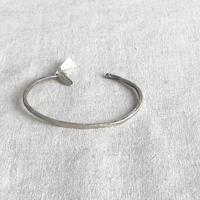 franny e fine jewelry /  silver cuff with silk tussle