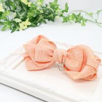 オレンジ系柔らか素材 ファブリックリボンのチャーム付きバレッタb138