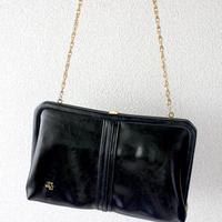 black frame clutch and shoulder bag