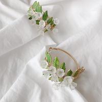 Green clear flower hoop pierce