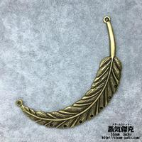 『大きな羽』穴あき 金属素材 商品番号W-0019