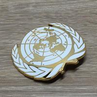 国連派遣部隊 PKO ベレー帽用金属製帽章(ゴールドカラー)
