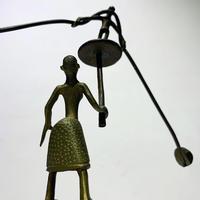 African swinging brass sculpture