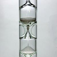 Floating liquid hourglass