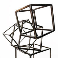 Geometric metal cube sculpture