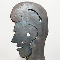 Handmade iron face sculpture