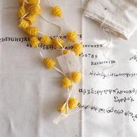 card_yaさんのキャンドル    braid (アンティークリネンの袋付き)