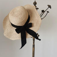 elegant black ribbon brimmed hat