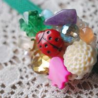おもちゃ箱みたいなぽっちり帯留め(1)