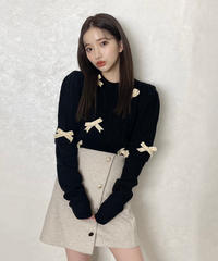 pearl design botton mini skirt
