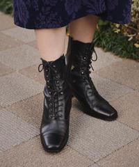 Yves Saint-Laurent / vintage leather boots.