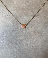 Chloe/butterfly motif gold necklace.(U)