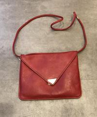 Yves Saint Laurent/vintage red leather shoulder bag.(U)
