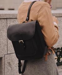 agnes b. / belt design leather backpack.