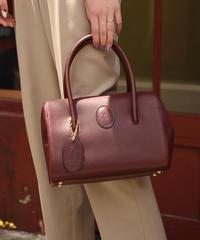 Cartier/vintage mustline mini boston bag.