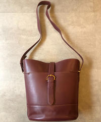 Cartier/vintage mustline shoulder bag.
