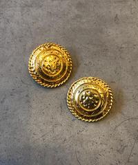Yves Saint Laurent/ vintage  gold round earring.(U)
