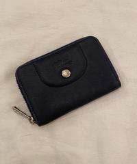 Longchamp/ vintage black leather coin case.