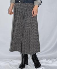 agnes b. / flower motif pleats skirt.