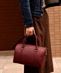 agnes.b / vintage wine-red leather hand bag. (U)