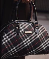 Burberry/black nova check hand bag.