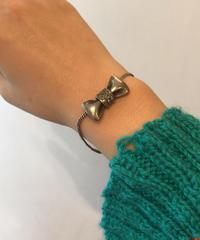 Chloe/ ribbon motif silver bracelet.