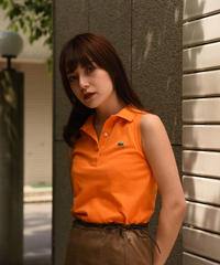 LACOSTE/ vintage no sleeve orange polo shirt .